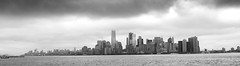 GREAT PANORAMIC OF FINANCIAL DISTRICT FROM LIBERTY ISLAND CLOUDS AFFECT ONE WORLD TRADE CENTER TOP UPPER BAY