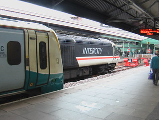 Swansea station with Arriva Trains Wales unit 175113 and 43185 in British Rail's Intercity Swallow livery.