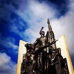 """Kupe Sculpture at Wellington Harbor From the plaque attached to the sculpture… """"Matahourua Te Waka, Ko Kupe Te Tangata, Ko Hine Te Aparangi Te Wahine Hupe Raiatea the explorer, his wife Hine Te Aparangi, and Pekahourangi the Tohunga, sight Aotearoa, New Z"""