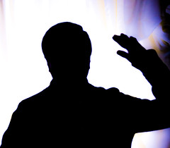 Silhouette - man waving.