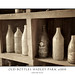 Aged dusty bottles on shelves at Hadley Park Farm