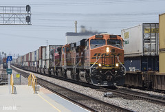 BNSF 7505 with a Warbonnet Trailing heads through Commerce