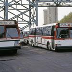US NJ Hoboken Red Apple Bus 2295-115 - Hoboken Yard - Ed Gibbs Photo - 4-17-1998.tif