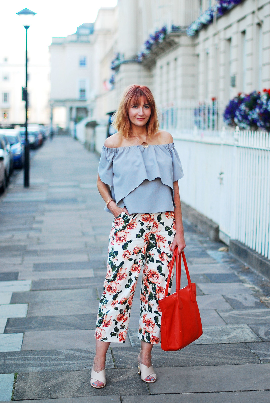 Summer style: Off the shoulder ruffle top, floral cropped trousers, orange tote | Not Dressed As Lamb, over 40 style