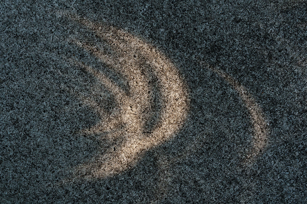 Cresent patterns on the sidewalk during a solar eclipse