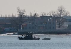 DPRK - boat passing Sinuiju