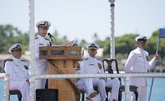 Rear Adm. Daryl L. Caudle addresses guests during the COMSUBPAC change of command ceremony aboard USS Jacksonville (SSN 699). (U.S. Navy/MC2 Michael Lee)