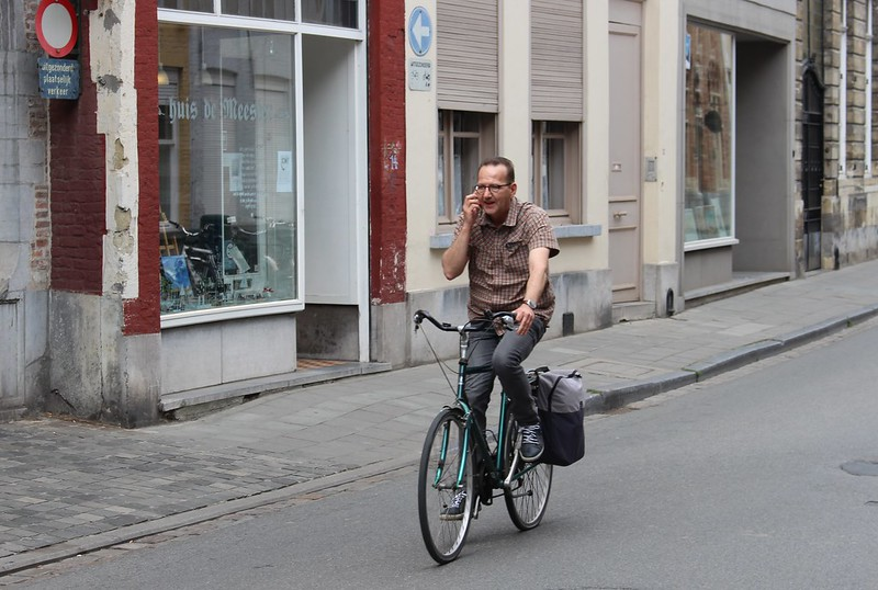 Cyclist on the phone in Brugge, Belgium