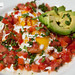 Huevos Rancheros - Refried Beans, Monterey Jack, Crema, Fried Eggs, Pico, Chipotle Salsa, Avocado, Cilantro