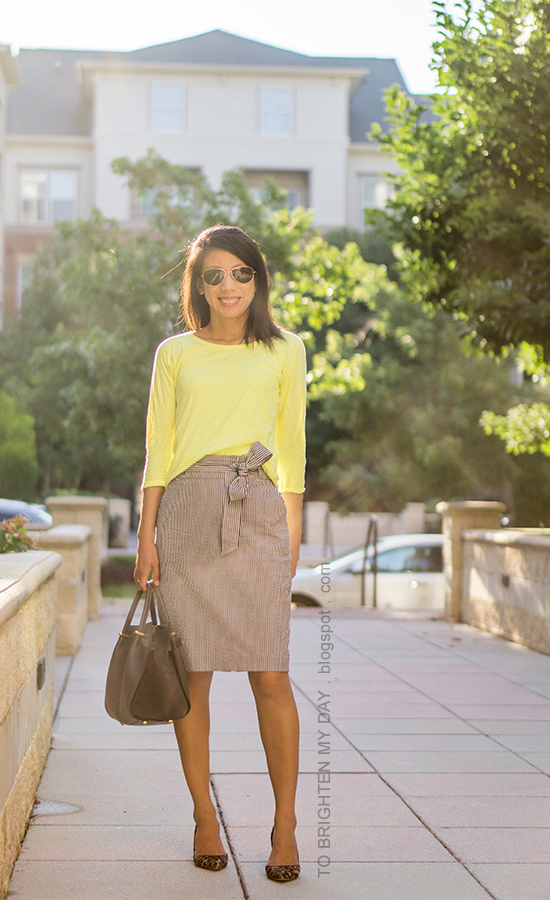 neon yellow top, striped seersucker pencil skirt with bow, gray tote, leopard pumps