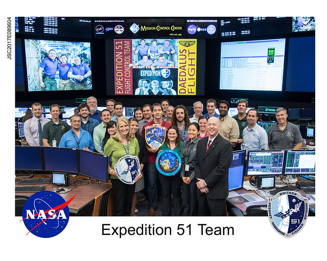 Hanging the Expedition 51 patch at NASA mission control