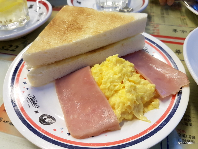 Buttered toast, ham, and scrambled eggs