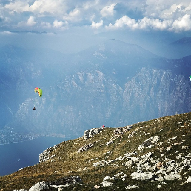 Mountain Adventure Nature Scenics Mountain Range Beauty In Nature Day Sky Parachute Leisure Activity Extreme Sports Outdoors Tranquility LakeGarda Landscape Wanderlust Wonderful Day Wonderful View Wonderful Place Cloud - Sky Tranquil Scene Paragliding Fly