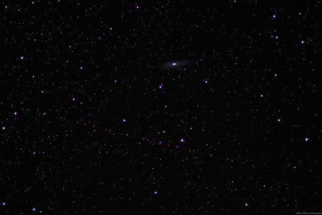 The Andromeda galaxy and lights of a passing plane