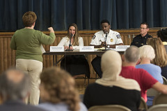 During a forum at Chase Elementary School to discuss police response times, Waterbury resident Debra Mannello said her daughter's car was shot with a BB gun while she was driving on Meriden Road but the police took nearly a full day to respond to the complaint, as State Representative Stephanie E. Cummings, Waterbury Police Chief Vernon L. Riddick Jr. , and Assistant Deputy Chief Edward Appicella listen intently.