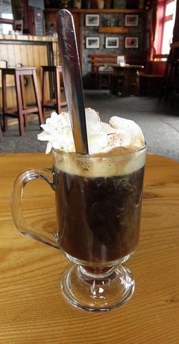 Having an Irish Coffee to warm me up on the Aran Island of Inisheer in Ireland