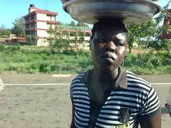 Ghanian woman roadside hawking, Accra, Ghana, #JujuFilms