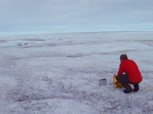 Dr Adam Booth monitoring a seismic explosion on the Greenland ice sheet