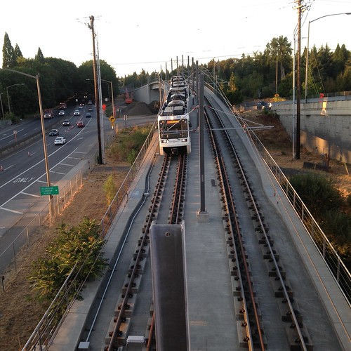 An Oak Grove-bound train takes the rollercoaster bridge just north of Tacoma Street