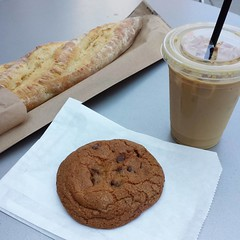 Stopped by the bakery after work today. Shhh, don't tell anyone about the cookie! Not the most glamorous photo, but I can't wait to tear into that baguette tonight! • 8.4.17 • #chocolatechipcookie #baguette #icedamericano #icedcoffee #chouxchouxbakery #ev
