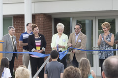 Rep. Melissa Ziobron and other invited school officials and guests applaud as the ribbon is cut to celebrate the recently renovated and expanded East Hampton High School.