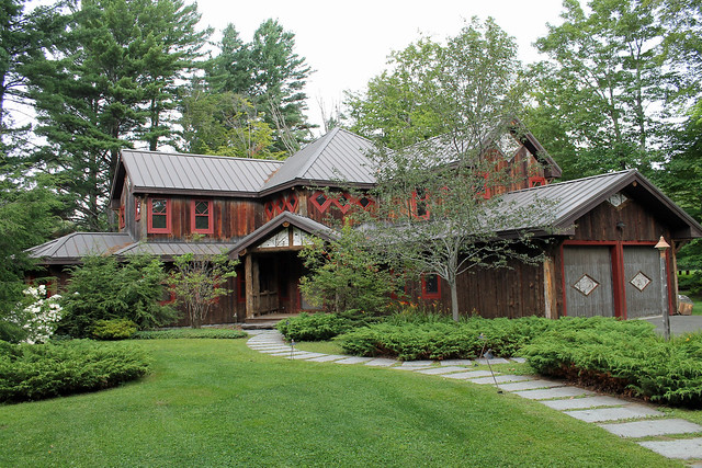 Custom built Adirondack Rustic style home with attached two car garage; situated on the end of a private drive overlooking the mountains and golf course at Whiteface Club Resort on the shore of Lake Placid lake;
