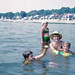 Left to Right: Me, a girlfriend, Mom in her straw hat and Sis in an inflatable turtle. I'm demonstrating how to make water bubbles by cupping your hand. 19th century cottages line the shoreline, not McMansions as today. Milford Connecticut. Aug 1966 by wavz13
