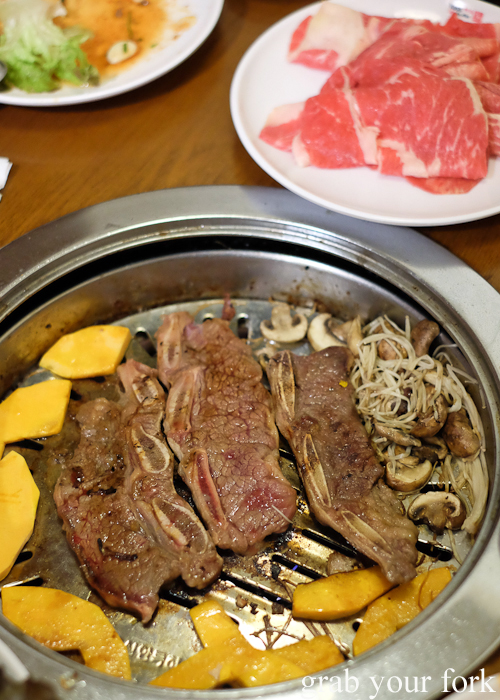 Beef ribs on the grill at Yass Korean BBQ Buffet in Strathfield Sydney