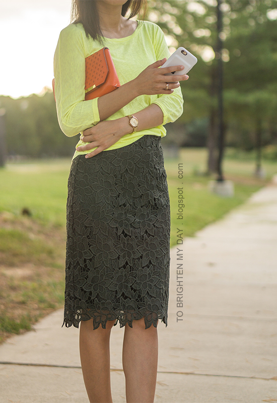 neon yellow top, orange clutch, olive green pencil skirt, gold watch