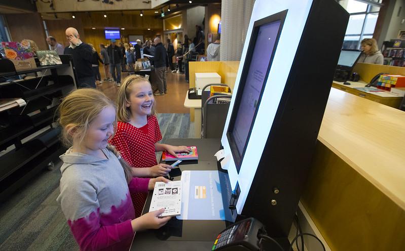 Kids using self-check machine