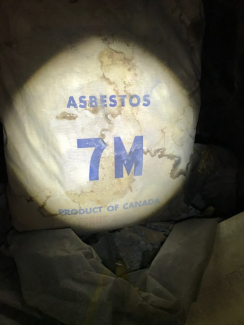 Bag of boiler insulation found in dark sub basement in a Newark NJ turn of the century building.