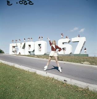 """""""Larkettes"""" posing at the Expo 67 site sign / « Larkettes » posant sur le site d'Expo 67"""