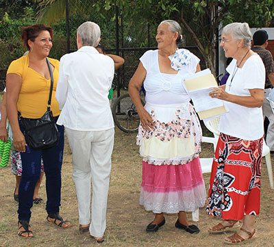 Sisters Kathryn (center) and Marilyn Charette (right) greeted the guests who came from 15 communities.