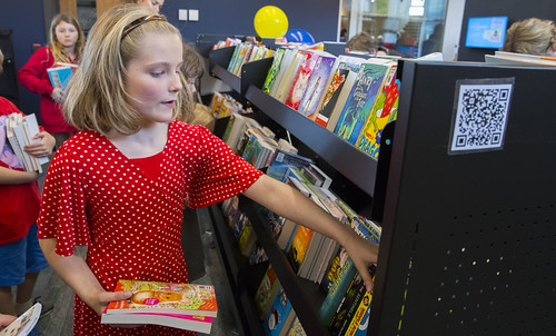 Choosing books, childrens area