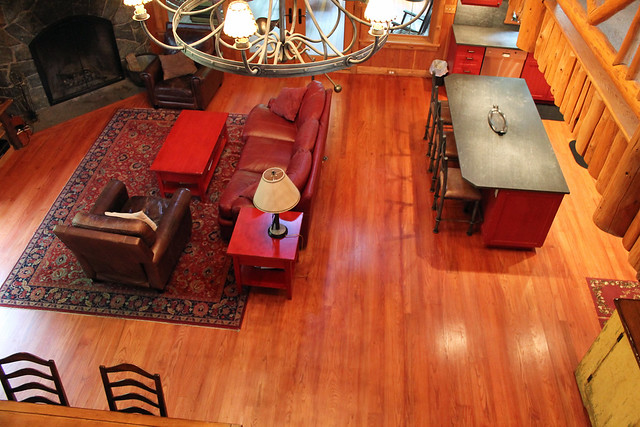 Looking down at the great room from the upper balcony; Hardwood floors, stone fireplace and open floor plan make this an idea home for entertaining;