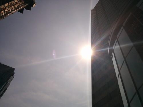 Sun glimpsed through glasses