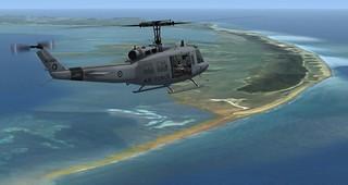 Bell UH-iH Iroquois NZ3804 over Farewell Spit