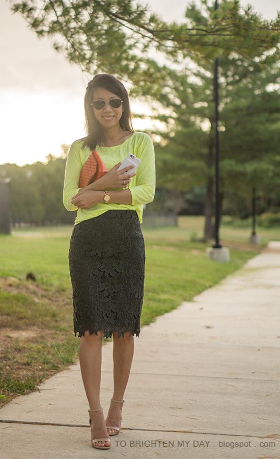 neon yellow top, orange clutch, olive green pencil skirt, nude heels, gold watch
