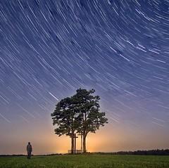 Stars trail or meditation close to cross