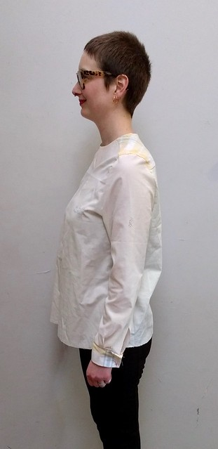A woman wearing an ill-fitting shirt muslin.