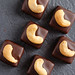 Handmade chocolate bonbons with cashew