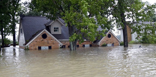 A home in Spring, Texas, is more than half-way under water due to historic flooding from Hurricane Harvey. (Photo: AP/David J Phillip)