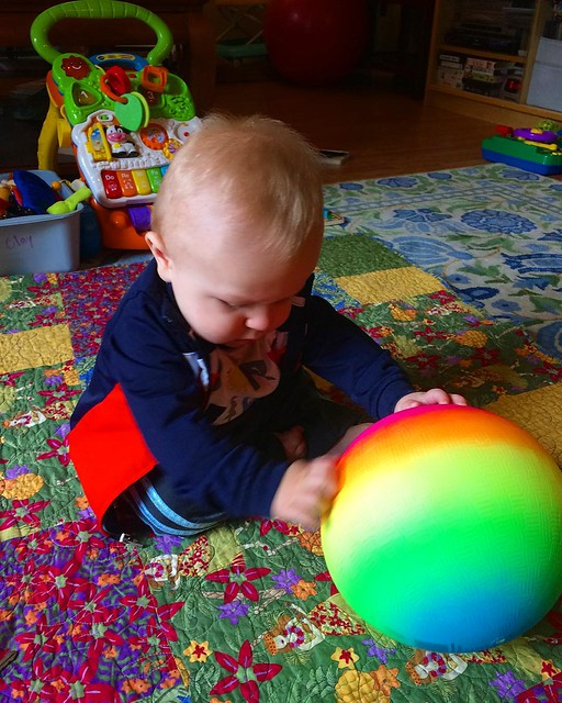 "Recently acquired neon rainbow ball. For, er, ""the baby"". 🌈"