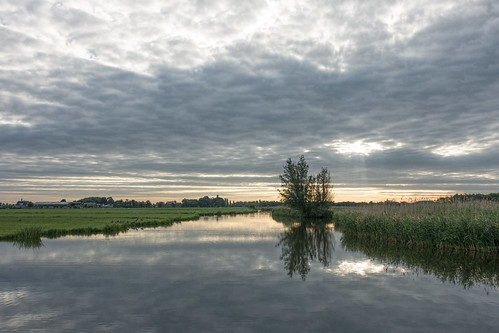 middendelfland clouds dawn landscape reflection water waterscape grass rays