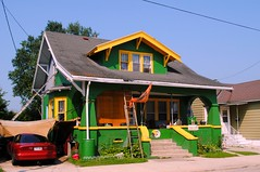 House getting painted Green Bay Packers colors.