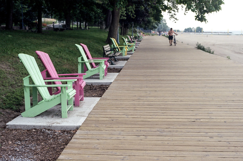Empty Muskoka Chairs on the Boardwalk