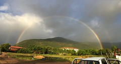 This is here , this morning at the #ishayogacenter. Beautiful way the sky decides to say #goodmorning #rainbow #doublerainbow. Look for the second arch trying it's best to form a bow again.
