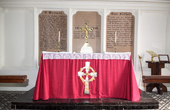 altar with creed and Our Father