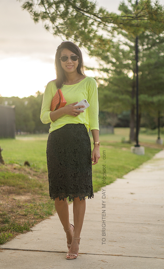 neon yellow top, orange clutch, olive green pencil skirt, nude heels, gold watch
