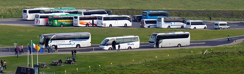 Only a few buses decorate the parking lot of the Cliffs of Moher in Ireland